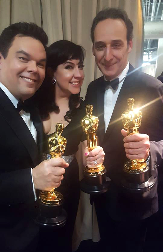 (From left) Robert Lopez, Kristen Anderson-Lopez and Alexandre Desplat backstage at the Oscars