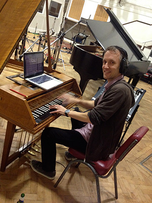 Conductor Andrew Skeet on harpsichord during <i>U.N.C.L.E.</i> session. (photo courtesy of Daniel Pemberton)