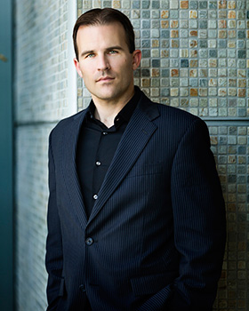 Conductor Justin Freer (Photo by Jeff Bandy)