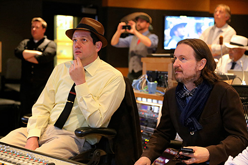 Michael Giacchino and Matt Reeves watch a playback during a recording session for \'Dawn of the Planet of the Apes\'.