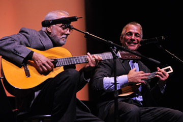 Guitarist Oscar Castro-Neves and song-and-dance man Tony Danza perform the Norman Gimbel-Michel Legrand hit