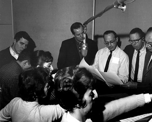 Ray Charles (in white shirt) instructs choir