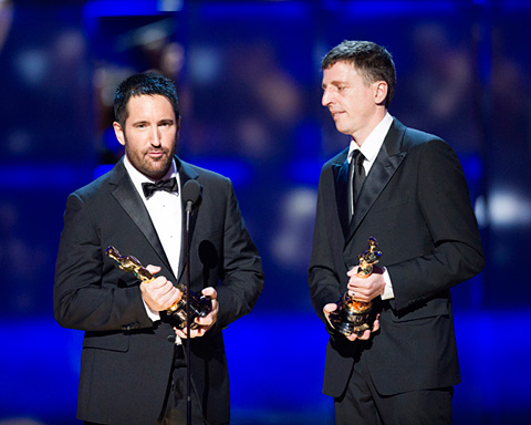 Trent Reznor and Atticus Ross accept the Oscar for Best Score.