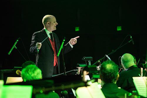 Conductor Steven Allen Fox leading a 32-piece orchestra