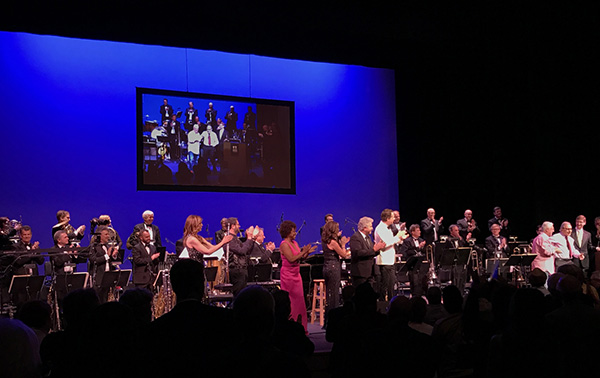 In front of orchestra (L to R): Sara Andon, Michael Giacchino, Sandra Booker, Denise Donatelli, Steve Tyrell, Chris Walden, Angel Romero, Lalo Schifrin, and Robert Townson