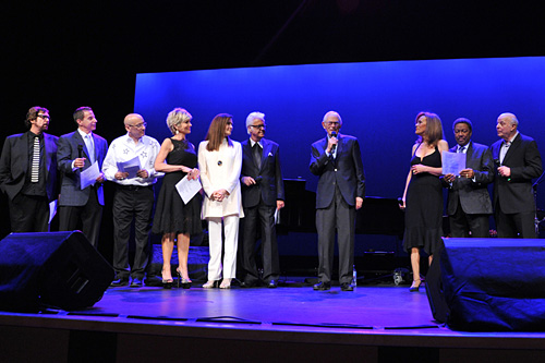 (Left to right) Stephen Bishop, Jud Friedman, Allan Rich, Debby Boone, Monica Mancini, Jack Jones, Alan Bergman, Marilyn McCoo, Billy Davis Jr. and Charles Fox in a grand finale sing-along of \'The Way We Were.\' (Photograph by Vince Bucci)